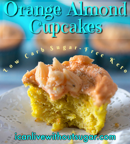 orange almond cupcakes, low carb sugar-free keto - this one with a small bite taken from it.